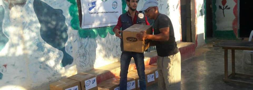 distribution de cartons de dons en Syrie